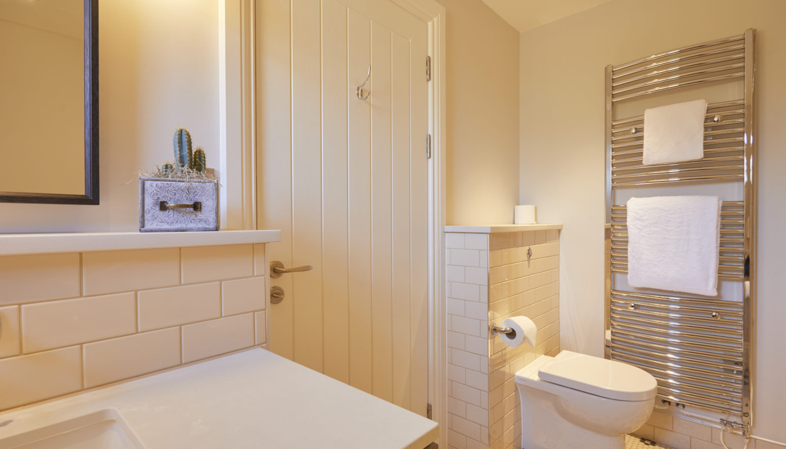Large double river view room bathroom suite at the Swan at Streatley