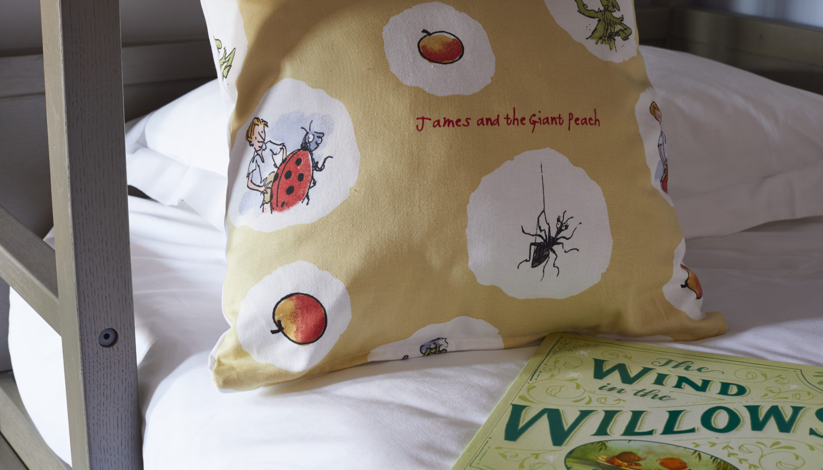 Family suite with fun cushions and books for children at riverside hotel The Swan at Streatley