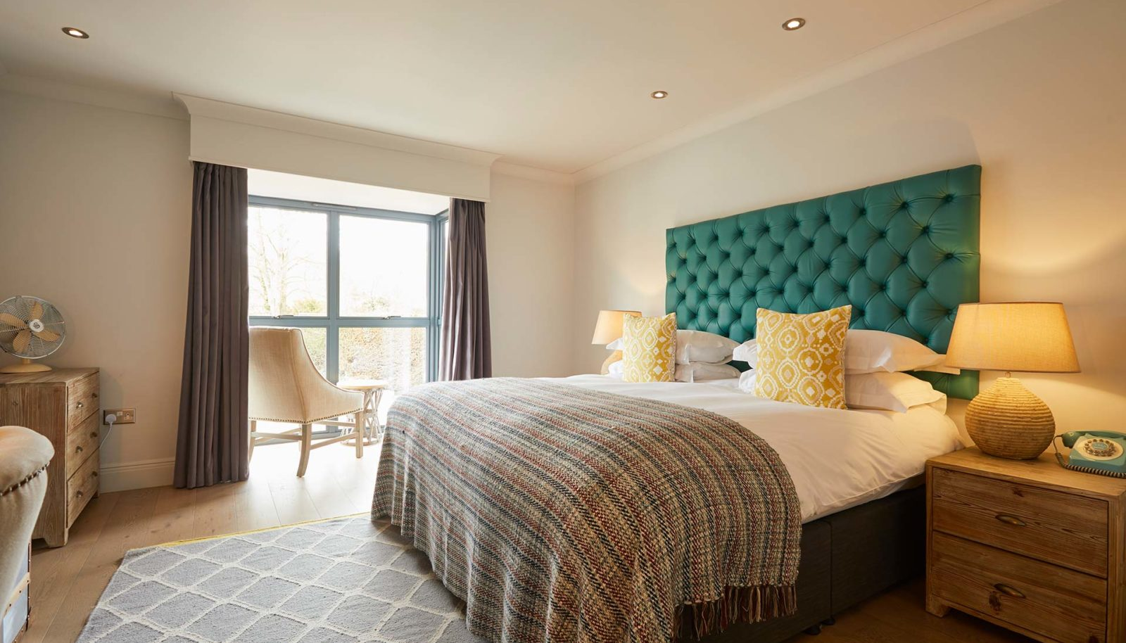 Medium double room with bed at riverside Hotel the Swan at Streatley