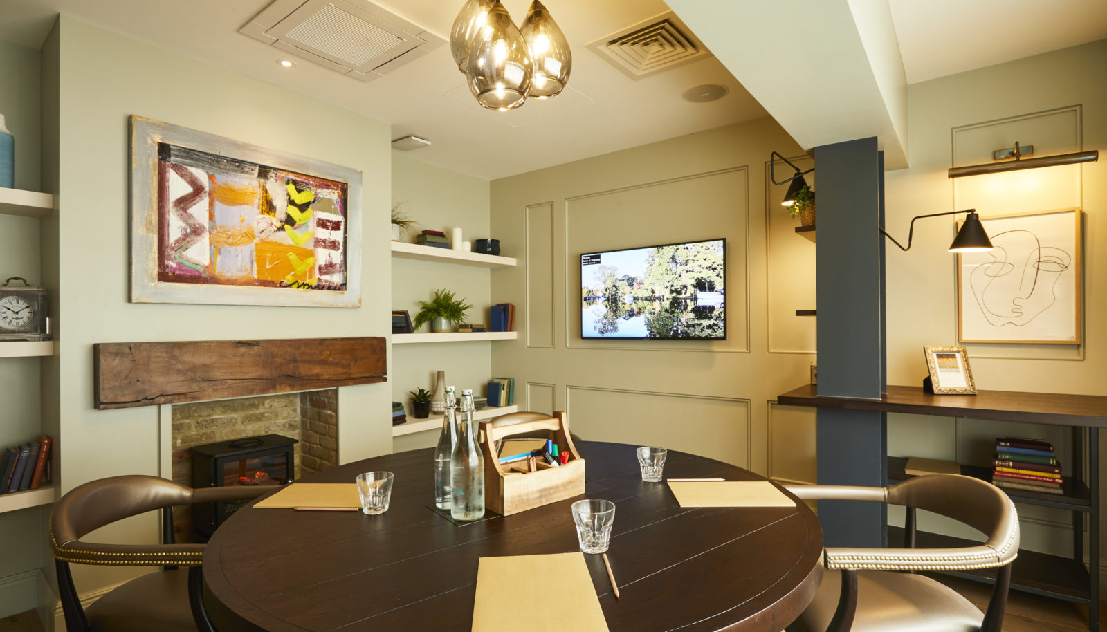 Wigeon meeting room at the Swan at Streatley events space with art and screen