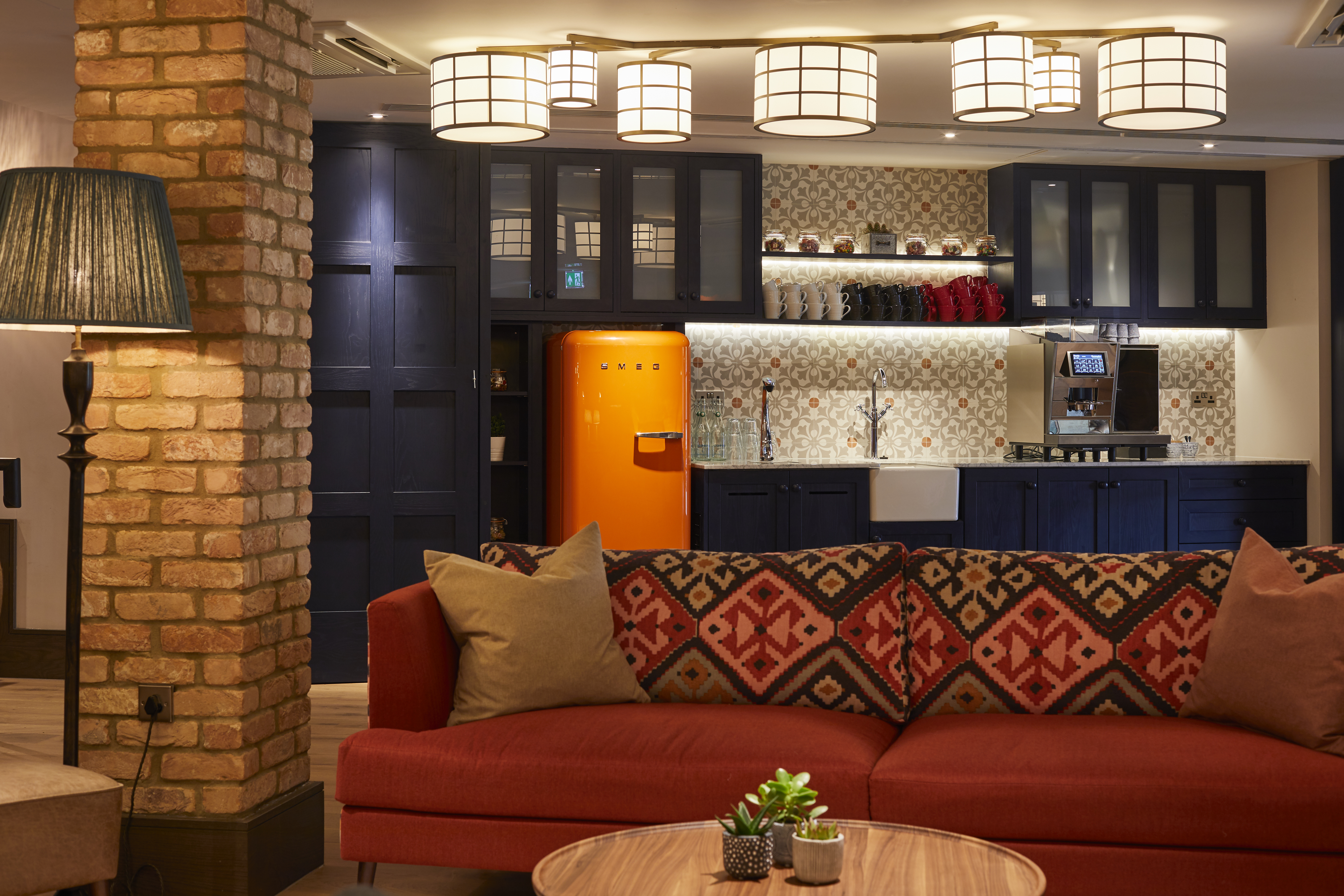 the pantry at the events space with smeg fridge and kilim orange sofa