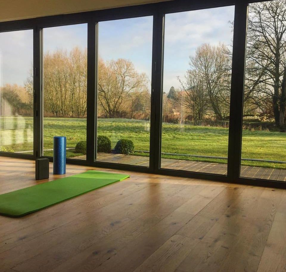 yoga studio with view over lawn and river